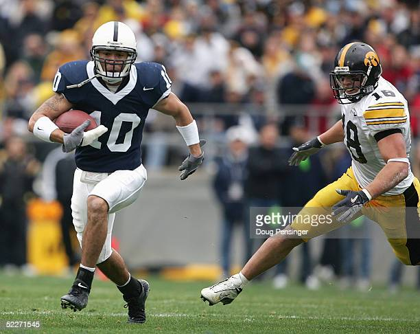 Safety Calvin Lowry of the Penn State Nittany Lions runs upfield from linebacker Chad Greenway of the Iowa Hawkeyes during the game at Beaver Stadium...