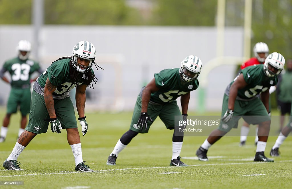 Safety Calvin Pryor #35 Linebacker Jeremiah George #53 and Linebacker Ike Enemkpali #51 of the New York Jets get set to run a special teams drill during the first day of rookie minicamp on May 16, 2014 in Florham Park, New Jersey.