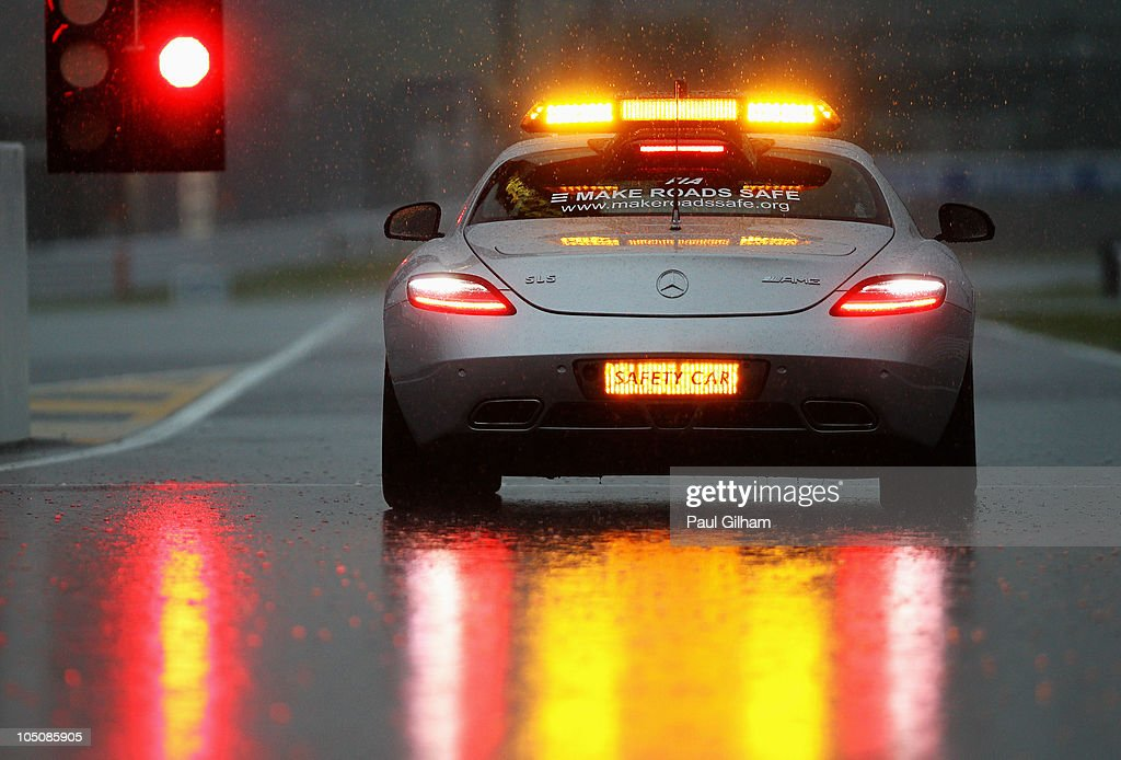 A. Safety Car drives down the pitlane as torrential rain causes the postponement of qualifying for the Japanese Formula One Grand Prix at Suzuka Circuit on October 9, 2010 in Suzuka, Japan.