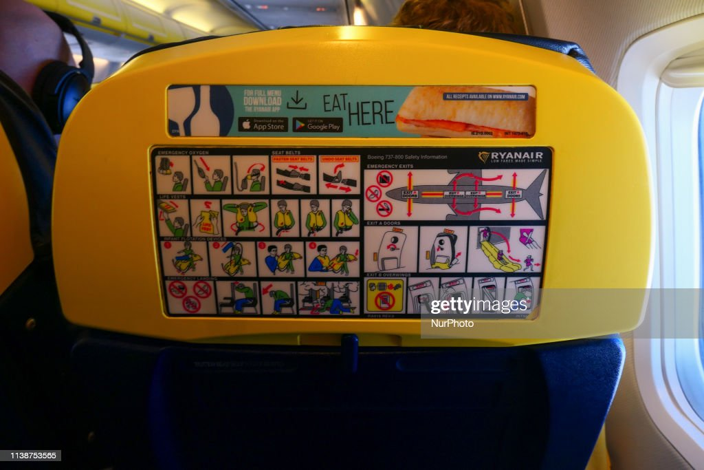 Safety card in the back of a seat inside a Ryanair low cost budget
