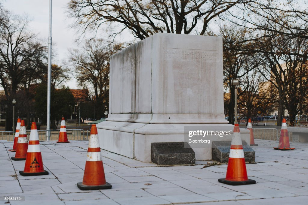 Safety cones stand around a pedestal, where the statue of General Nathan Bedford Forrest stood before it was removed, at a park in Memphis, Tennessee, U.S., on Thursday, Dec. 21, 2017. The City Council voted unanimously on Wednesday to sell two Memphis parks where Confederate statues were located. The parks were sold to Greenspace Inc. for $1,000 each, according to The Commercial Appeal. Photographer: Houston Cofield/Bloomberg via Getty Images