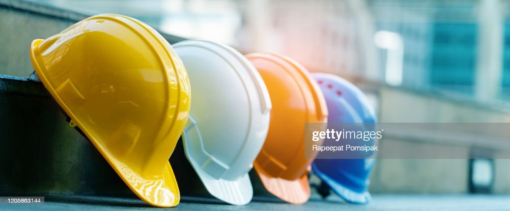 Safety Construction Worker Hats Blue, white, yellow, orange. Teamwork of construction team must have quality. Whether it engineer, construction workers. Have a helmet to wear at work. Safety at work. : Stock Photo