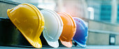 Safety Construction Worker Hats Blue, white, yellow, orange. Teamwork of construction team must have quality. Whether it engineer, construction workers. Have a helmet to wear at work. Safety at work.