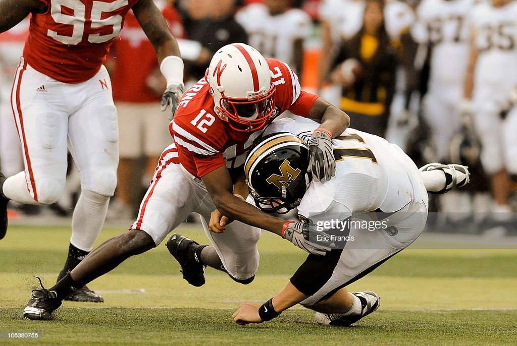 Safety Courtney Osborne #12 of the Nebraska Cornhuskers hits quarterback Blaine Gabbert #11 of the Missouri Tigers during second half action of their game at Memorial Stadium on October 30, 2010 in Lincoln, Nebraska. Nebraska Defeated Missouri 31-17.