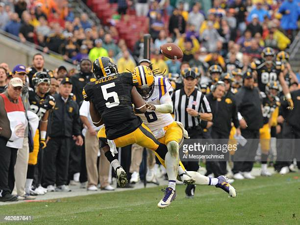 Safety Craig Loston of the LSU Tigers breaks up a pass intended for running back Damon Bullock of the Iowa Hawkeyes January 1 2014 in the Outback...