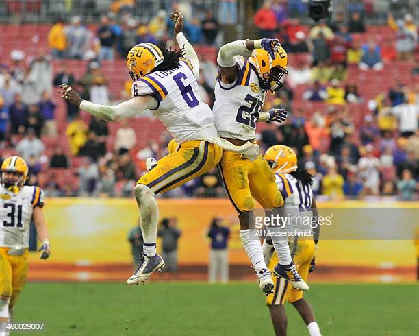 Safety Craig Loston of the LSU Tigers celebrates after breaking up a pass intended for running back Damon Bullock of the Iowa Hawkeyes January 1 2014...