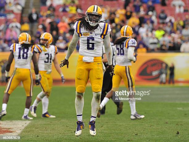 Safety Craig Loston of the LSU Tigers celebrates after breaking up a pass against the Iowa Hawkeyes January 1 2014 in the Outback Bowl at Raymond...