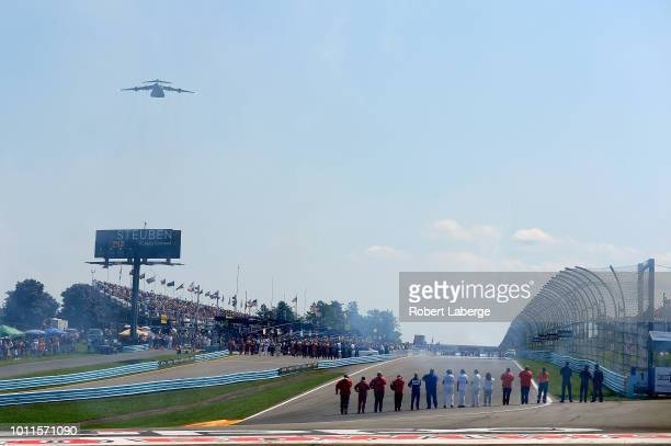 Safety crew members stand on pit road during a flyover before the start of the Monster Energy NASCAR Cup Series GoBowling at The Glen at Watkins Glen...