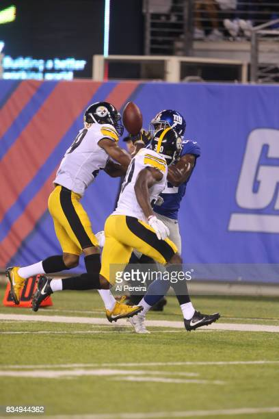 Safety Daimion Stafford of the Pittsburgh Steelers breaks up a pass against the New York Giants during an NFL preseason game at MetLife Stadium on...
