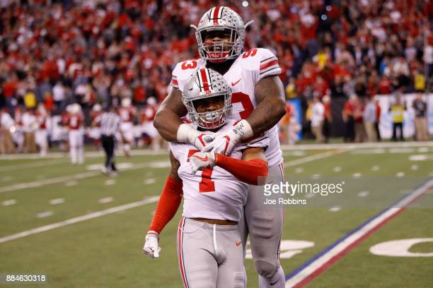 Safety Damon Webb and defensive lineman Tracy Sprinkle of the Ohio State Buckeyes celebrate their 2721 win over the Wisconsin Badgers during the Big...
