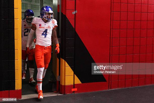 Safety Darian Thompson of the Boise State Broncos walks out to the field for warm ups to the Vizio Fiesta Bowl against the Arizona Wildcats at...