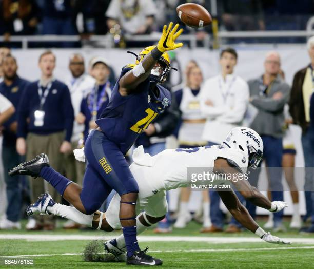 Safety DeDarallo Blue of the Toledo Rockets knocks the ball away from wide receiver Tra'Von Chapman of the Akron Zips during a first half pass play...