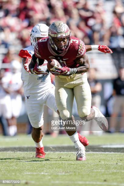 Safety Derwin James of the Florida State Seminoles makes an interception for a touchdown during the game against the Delaware State Hornets at Doak...