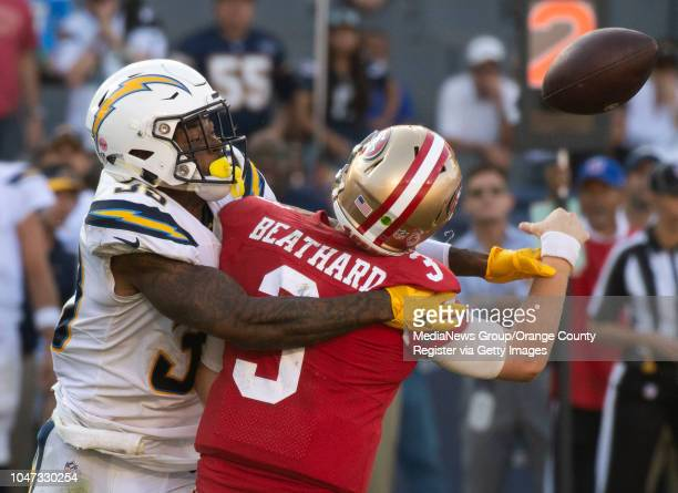 Safety Derwin James of the Los Angeles Chargers forces an interception by quarterback CJ Beathard of the San Francisco 49ers to seal the win during...