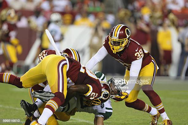 Safety Deshazor Everett of the Washington Redskins makes a stop against the New York Jets at FedExField on August 19 2016 in Landover Maryland