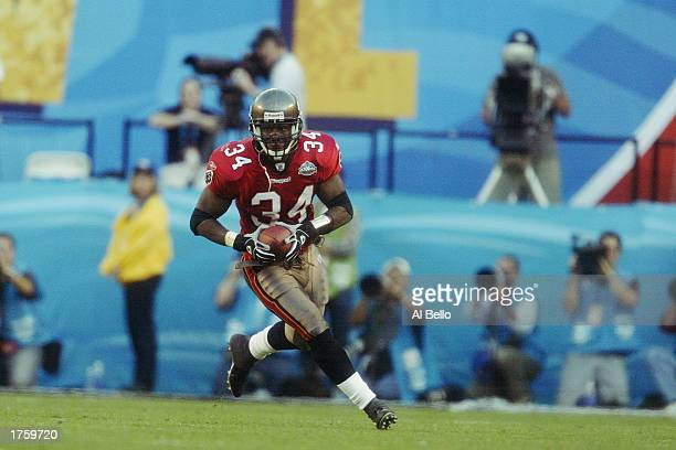 MVP safety Dexter Jackson of the Tampa Bay Buccaneers makes a second quarter interception against the Oakland Raiders in Super Bowl XXXVII at...