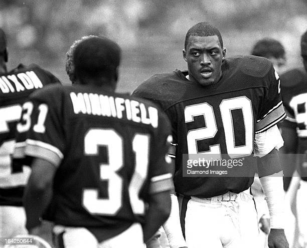 Safety Don Rogers and cornerback Frank Minnifield of the Cleveland Browns walk on the sidelines during a game against New England Patriots on Sunday...
