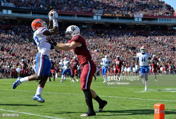 Safety Donovan Stiner of the Florida Gators intercepts a pass intended for tight end Hayden Hurst of the South Carolina Gamecocks during their game...