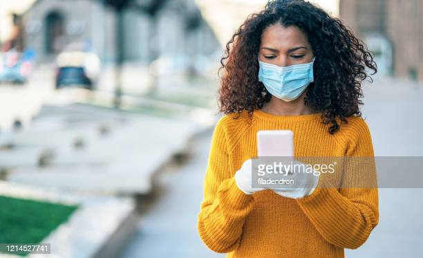 safety during covid-19 pandemic - black glove stock pictures, royalty-free photos & images