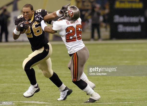 Safety Dwight Smith of the Tampa Bay Buccaneers attempts to tackle Deuce McAllister of the New Orleans Saints during the game at the Superdome on...