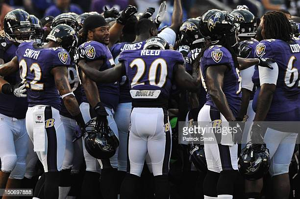 Safety Ed Reed of the Baltimore Ravens huddles up with teammates before playing the Jacksonville Jaguars during the preseason game at MT Bank Stadium...