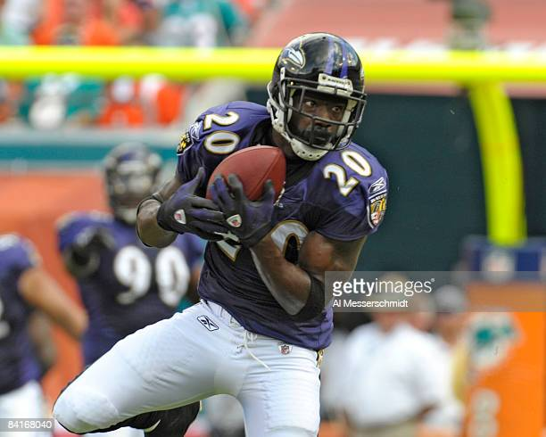Safety Ed Reed of the Baltimore Ravens intercepts a pass against the Miami Dolphins in an AFC wild card game at Dolphins Stadium January 4 2009 in...