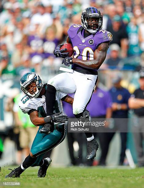 Safety Ed Reed of the Baltimore Ravens is tackled by wide receiver Damaris Johnson of the Philadelphia Eagles after Reed intercepted a Michael Vick...