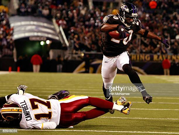 Safety Ed Reed of the Baltimore Ravens returns a fumble for a touchdown as he leaps over quarterback Jason Campbell of the Washington Redskins...