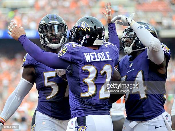 Safety Eric Weddle and linebacker Zachary Orr of the Baltimore Ravens celebrate a game winning interception by linebacker CJ Mosley during a game...