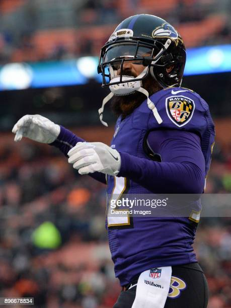Safety Eric Weddle of the Baltimore Ravens walks off the field after an interception in the endzone by cornerback Brandon Carr in the fourth quarter...