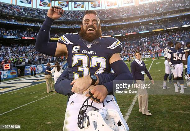 Safety Eric Weddle of the San Diego Chargers celebrates as he is lifted after the game with the Kansas City Chiefs at Qualcomm Stadium on December 29...