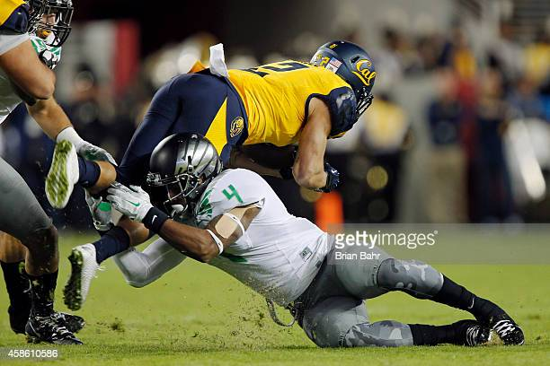 Safety Erick Dargan of the Oregon Ducks tackles running back Daniel Lasco of the California Golden Bears for a sixyard gain on the first play of the...