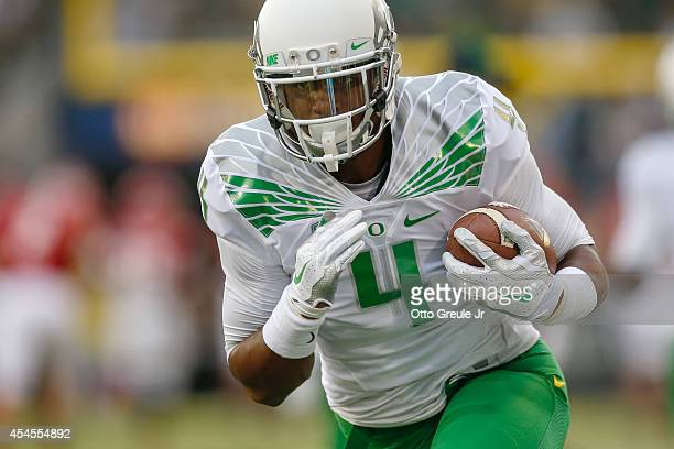 Safety Erick Dargan of the Oregon Ducks warms up prior to the game against the South Dakota Coyotes at Autzen Stadium on August 30 2014 in Eugene...