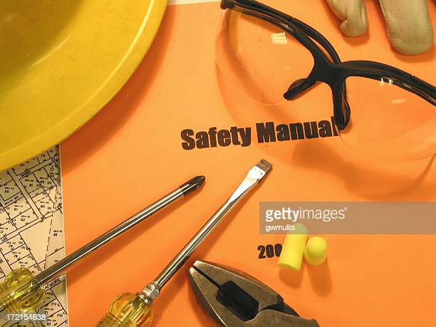 safety first 2 - handbook stock photos and pictures
