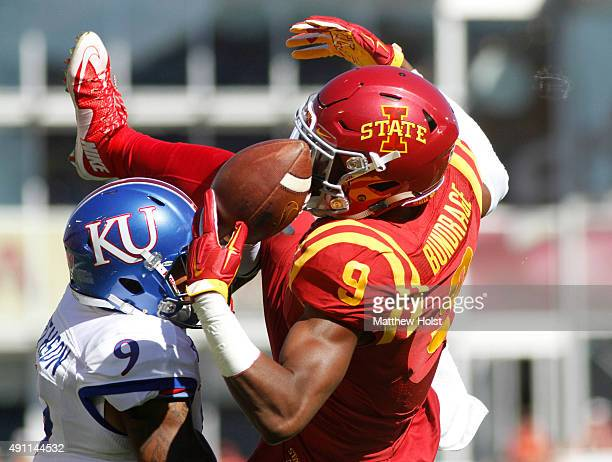 Safety Fish Smithson of the Kansas Jayhawks breaks up a pass in the first quarter intended for wide receiver Quenton Bundrage of the Iowa State...