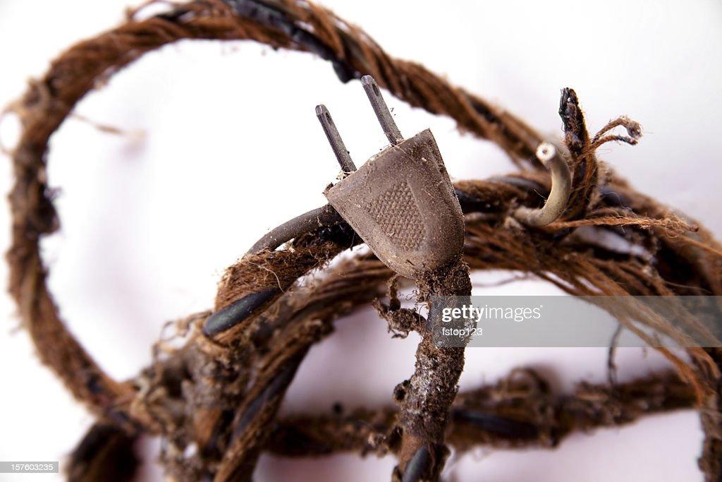 Safety.  Frayed old electrical cord, plug. Safety hazard. : Stock Photo