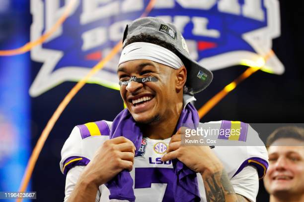 Safety Grant Delpit of the LSU Tigers celebrate on the podium after winning the Chick-fil-A Peach Bowl 28-63 over the Oklahoma Sooners at...