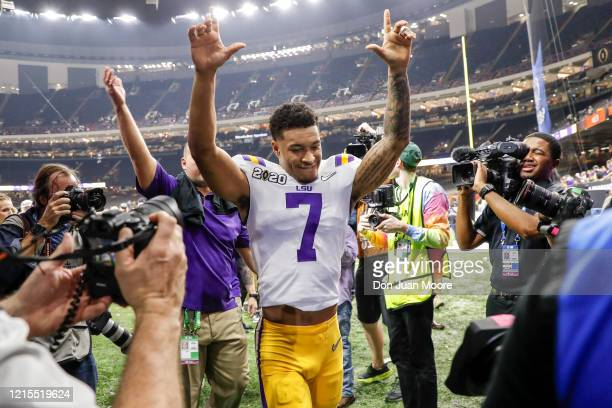 Safety Grant Delpit of the LSU Tigers raises his hands to the fans while he is leaving the field after the College Football Playoff National...