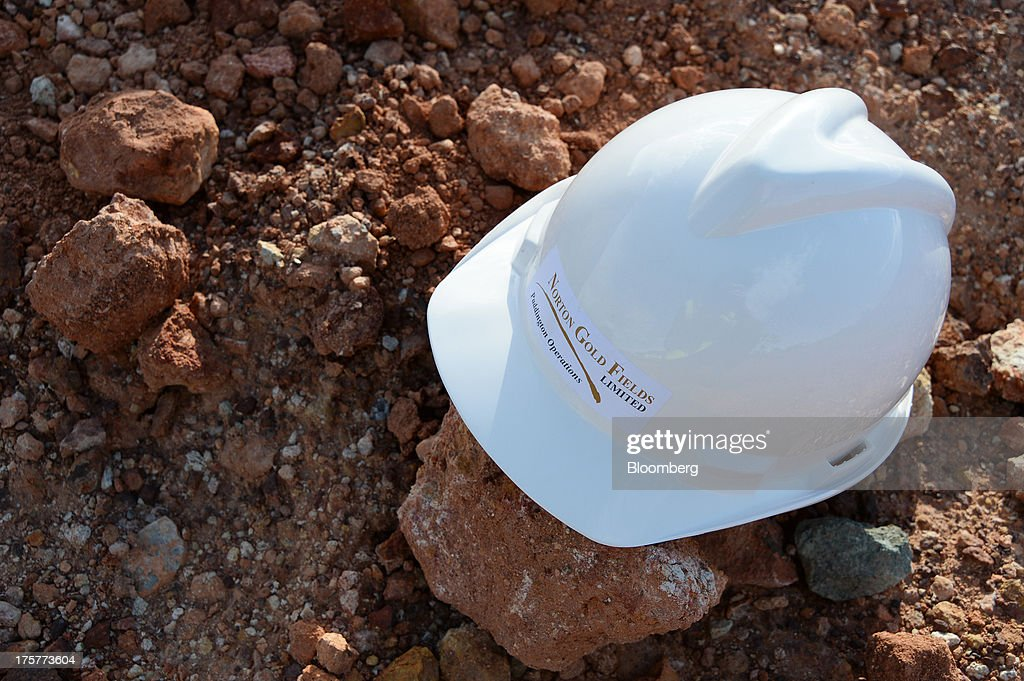 A safety helmet is arranged for a photograph at the Norton Gold Fields Ltd. Enterprise operations 68 kilometers north-west of Kalgoorlie, Australia, on Wednesday, Aug. 7, 2013. Norton, the Australian producer controlled by China's Zijin Mining Group Co., is seeking further acquisition targets as falling prices cut the value of mines. Photographer: Carla Gottgens/Bloomberg via Getty Images