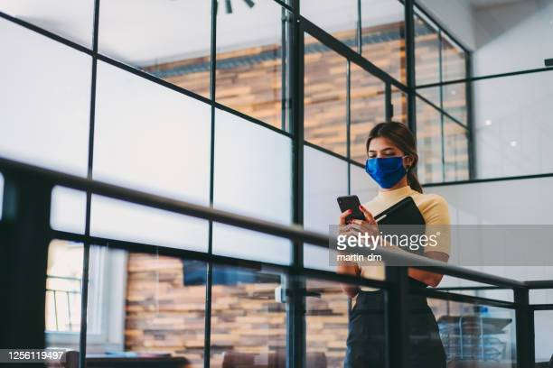 safety in the office during covid-19 pandemic, businesswoman with face mask - prevention stock pictures, royalty-free photos & images