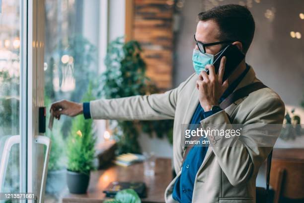 safety in the office during covid-19 pandemic - safe security equipment stock pictures, royalty-free photos & images