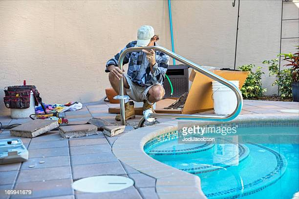 safety: installing a pool hand rail - installing stock pictures, royalty-free photos & images