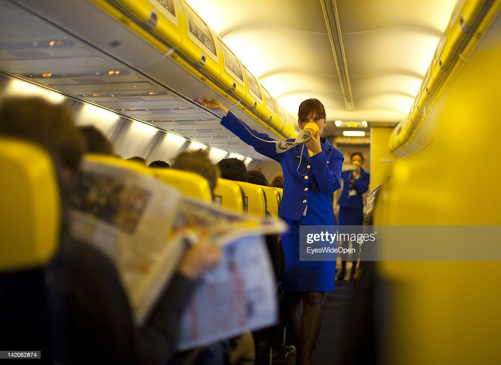 Safety instructions shown by a stewardess for Passengers boarding for departure of a RyanAir flight to Alicante, Spain at Allgaeu Airport on February 18, 2012 in Memmingen, Germany.