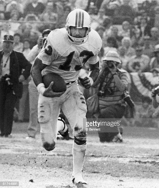 Safety Jake Scott of the Miami Dolphins returns an interception during Super Bowl VII against the Washington Redskins on January 14 1973 at Memorial...