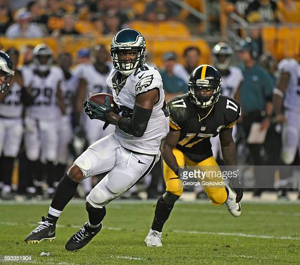 Safety Jalen Watkins of the Philadelphia Eagles runs with the football after intercepting a pass intended for wide receiver Eli Rogers of the...