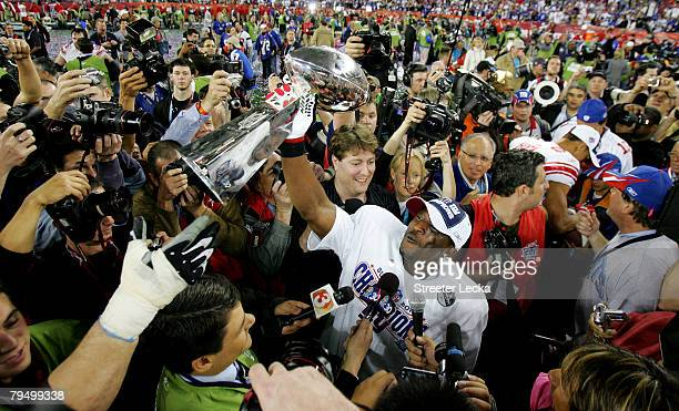 Safety James Butler of the New York Giants holds the Vince Lombardi Trophy after defeating the New England Patriots 1714 in Super Bowl XLII on...
