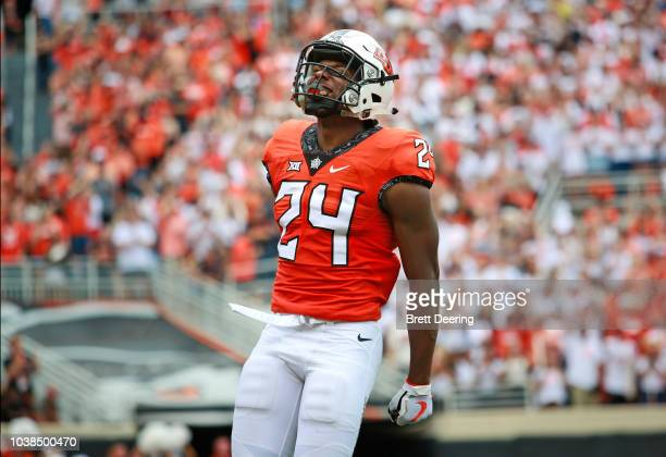 Safety Jarrick Bernard of the Oklahoma State Cowboys celebrates a blocked punt against the Boise State Broncos at Boone Pickens Stadium on September...