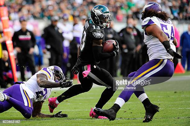 Safety Jayron Kearse of the Minnesota Vikings left can't hang onto wide receiver Josh Huff of the Philadelphia Eagles as middle linebacker Eric...