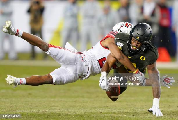 Safety Jevon Holland of the Oregon Ducks breaks up this pass to wide receiver Jaylen Dixon of the Utah Utes during the first half of the Pac12...