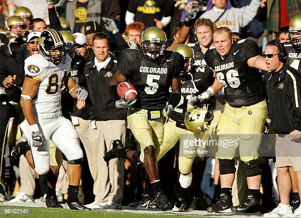 Safety JJ Billingsley of the Colorado Buffaloes returns a fumble 36 yards down the sideline to the delight of his teammates as wide receiver Tommy...